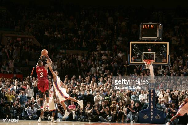 Dwyane Wade of the Miami Heat shoots the winning basket over Trevor Ariza of the New York Knicks on March 15 2005 at Madison Square Garden in New...