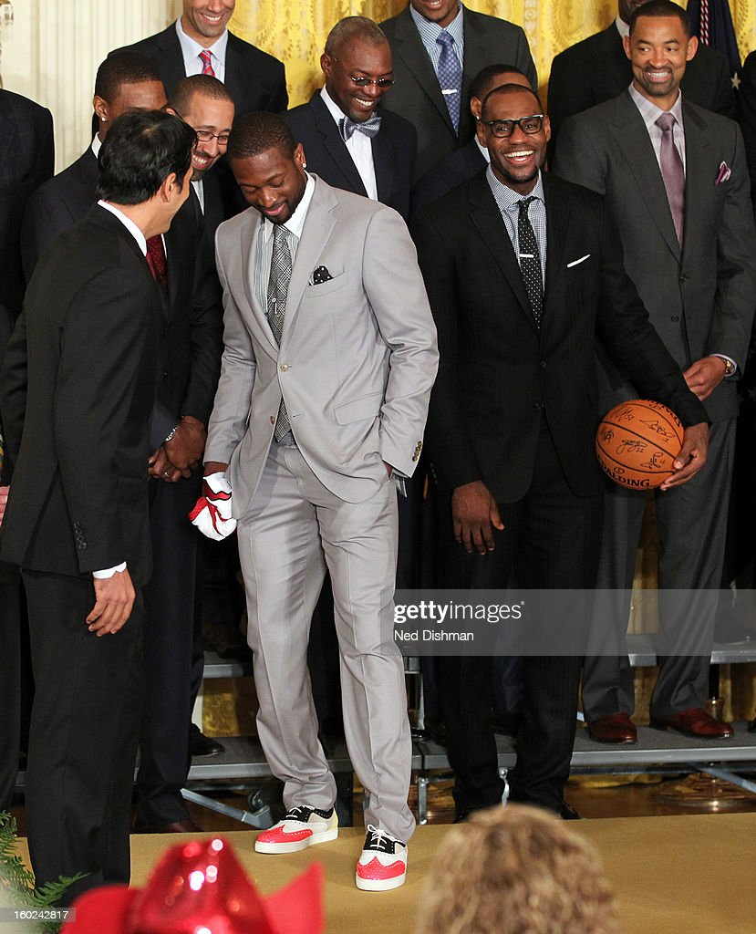 Dwyane Wade #3 of the Miami Heat shows off his shoes during a visit by the Miami Heat to the White House to commemorate the 2012 NBA Champions on January 28, 2013 in Washington, DC.