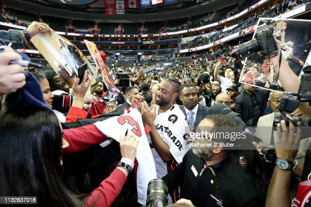 Dwyane Wade of the Miami Heat signs autographs after the game against the Washington Wizards on March 23 2019 at Capital One Arena in Washington DC...