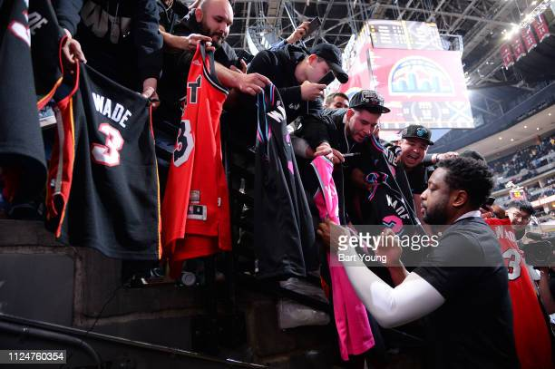 Dwyane Wade of the Miami Heat signs autographs for fans after the game against the Denver Nuggets on February 11 2019 at the Pepsi Center in Denver...