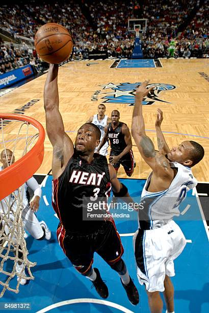 Dwyane Wade of the Miami Heat slam dunks against Rashard Lewis of the Orlando Magic during the game on February 22 2009 at Amway Arena in Orlando...