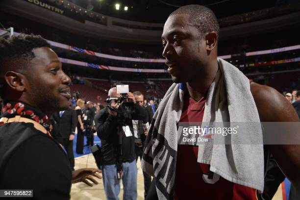 Dwyane Wade of the Miami Heat speaks to Antonio Brown after the game against the Philadelphia 76ers in Game Two of Round One of the 2018 NBA Playoffs...