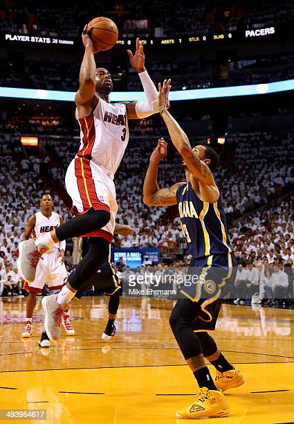 Dwyane Wade of the Miami Heat takes a shot as George Hill of the Indiana Pacers defends during Game Four of the Eastern Conference Finals of the 2014...