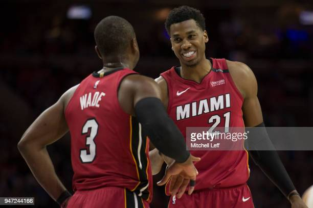 Dwyane Wade of the Miami Heat talks with Hassan Whiteside in the second quarter against the Philadelphia 76ers during Game Two of the first round of...