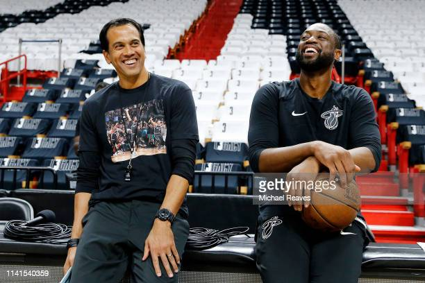 Dwyane Wade of the Miami Heat talks with head coach Erik Spoelstra prior to his final regular season home game of his career against the Philadelphia...