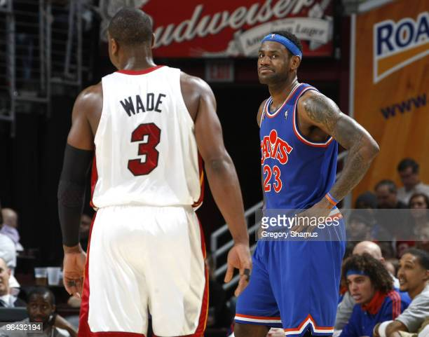 Dwyane Wade of the Miami Heat talks with LeBron James of the Cleveland Cavaliers on February 4 2010 at the Quicken Loans Arena in Cleveland Ohio...