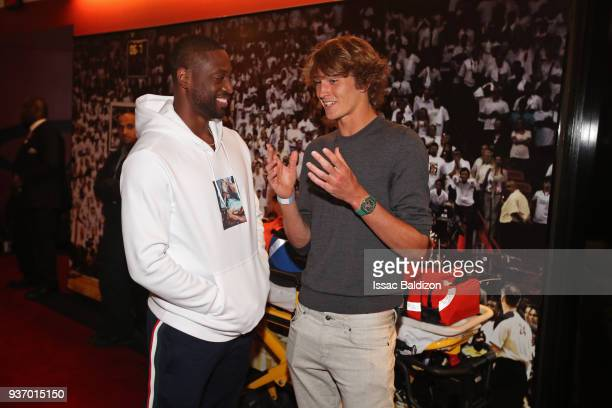 Dwyane Wade of the Miami Heat talks with Tennis Player Alexander Zverev after the game against the New York Knicks on March 21 2018 at American...