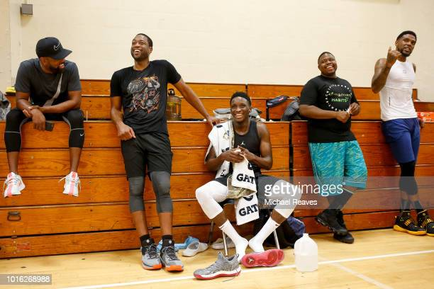 Dwyane Wade of the Miami Heat Victor Oladipo of the Indiana Pacers and NBA skills trainer Stanley Remy react during NBA Offseason training with Remy...