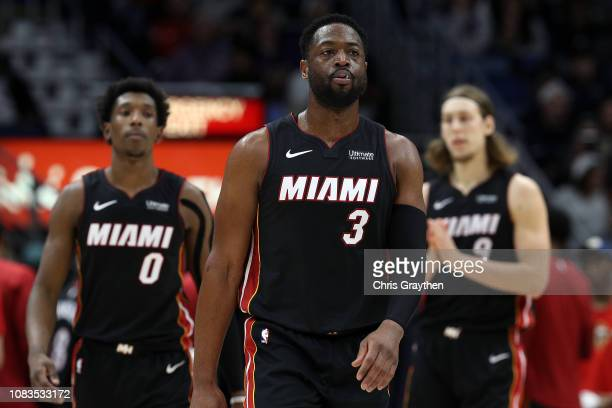 Dwyane Wade of the Miami Heat walks on the court during the game against the New Orleans Pelicans at the Smoothie King Center on December 16 2018 in...