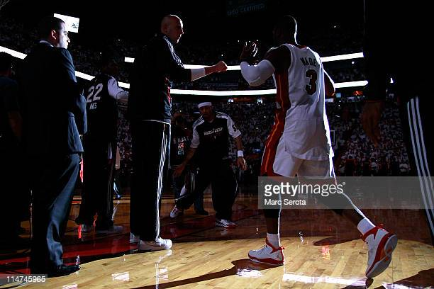 Dwyane Wade of the Miami Heat walks onto the court during player introductions against the Chicago Bulls in Game Four of the Eastern Conference...