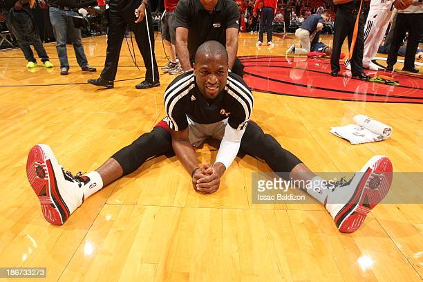 Dwyane Wade of the Miami Heat warms up before the game against the Washington Wizards on November 3 2013 at American Airlines Arena in Miami Florida...