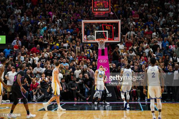 Dwyane Wade of the Miami Heat watches as his shot goes in at the buzzer in a game against the Golden State Warriors at American Airlines Arena on...