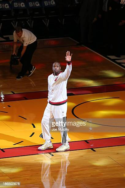 Dwyane Wade of the Miami Heat waves to the crowd against the Chicago Bulls on October 29 2013 at American Airlines Arena in Miami Florida NOTE TO...