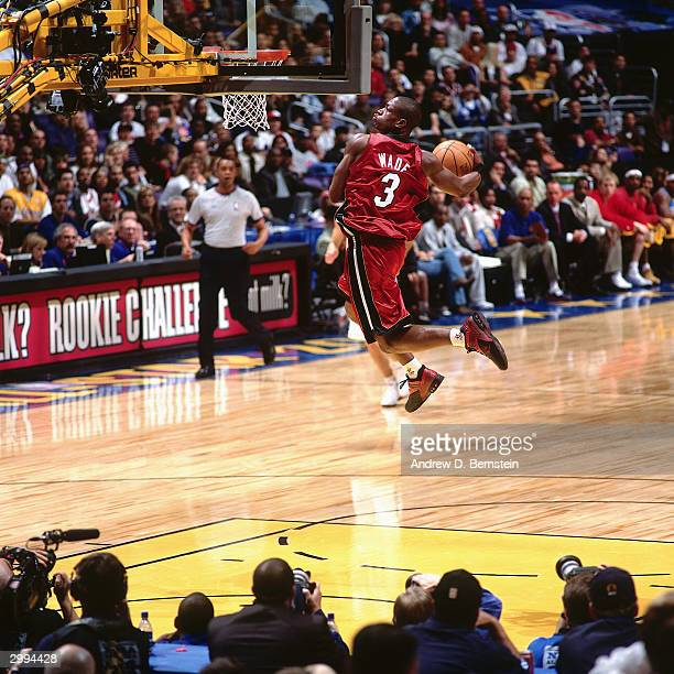 Dwyane Wade of the Rookie Team drives to the basket for a dunk against the Sophomore Team during the Got Milk Rookie Challenge a part of the 2004 NBA...