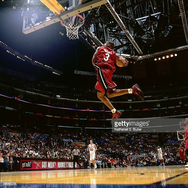 Dwyane Wade of the Rookie Team dunks against the Sophomore Team during the got milk Rookie Game on February 13 2004 at Staples Center in Los Angeles...