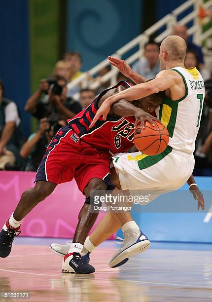 Dwyane Wade of the United States and Saulius Stombergas of Lithuania clash during the men's basketball bronze medal contest game on August 28 2004...