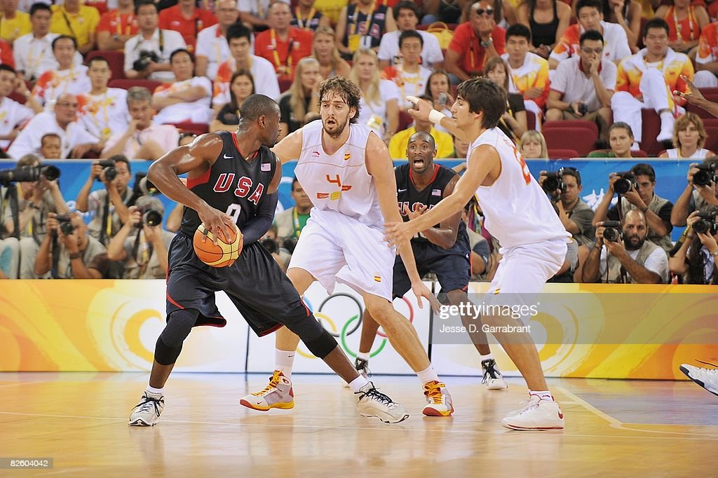 Dwyane Wade #9 of the United States drives the ball against Pau Gasol #4 and Ricky Rubio #6 of Spain during the gold medal game of the 2008 Beijing Summer Olympics at the Beijing Olympic Basketball Gymnasium on August 24, 2008 in Beijing, China. The United States defeated Spain 118-107 to take the men's gold medal.
