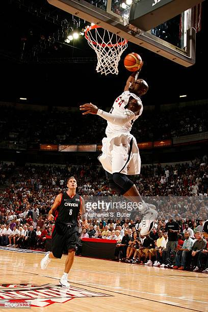 Dwyane Wade of the United States Men's Senior National Basketball Team dunks against Carl English during the game against the Canadian Men's Senior...