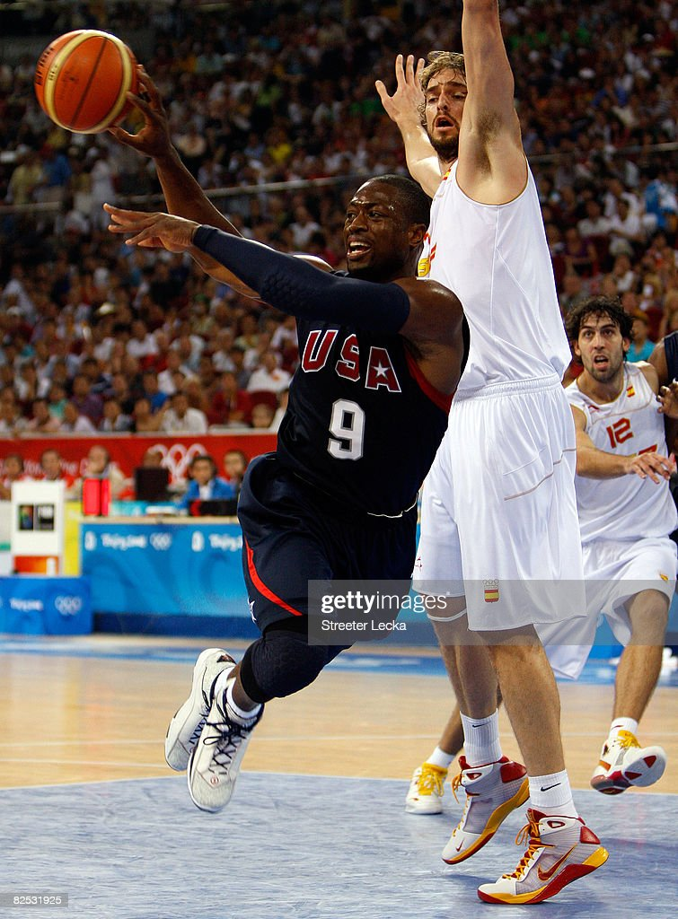 Dwyane Wade #9 of the United States passes against the defense of Pau Gasol #4 of Spain during the gold medal game during Day 16 of the Beijing 2008 Olympic Games at the Beijing Olympic Basketball Gymnasium on August 24, 2008 in Beijing, China.