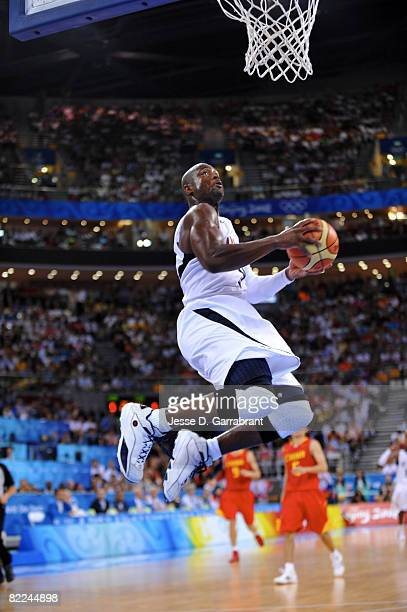 Dwyane Wade of the US Men's Senior National Team dunks against China during day 2 of the men's preliminary basketball game at the 2008 Beijing...