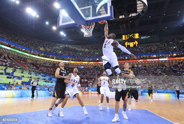 Dwyane Wade of the US Men's Senior National Team dunks against Germany during the men's group B basketball preliminaries at the 2008 Beijing Olympic...