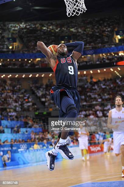 Dwyane Wade of the U.S. Men's Senior National Team dunks against Spain during the group B preliminary basketball game at the Beijing Olympic...