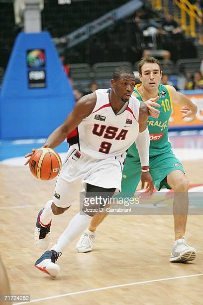 Dwyane Wade of the USA Basketball Mens National Team goes to the basket against Jason Smith of Australia during the FIBA World Basketball...