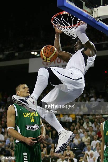 Dwyane Wade of the USA Basketball Men's Senior National Team dunks against the Lithuania National Team during the USA Basketball International...