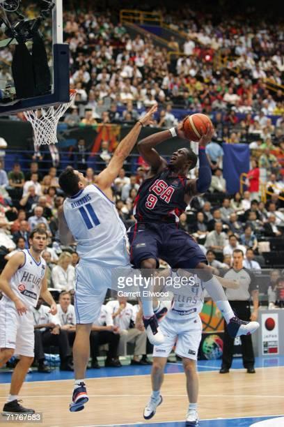 Dwyane Wade of the USA Basketball Men's Senior National Team goes to the basket against Dimos Dikoudis of Greece during the FIBA World Basketball...