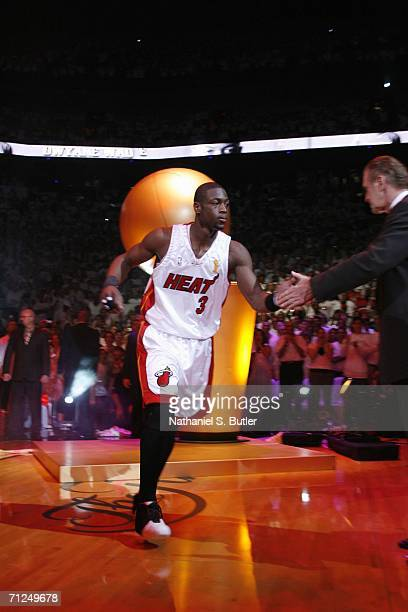 Dwyane Wade slaps five with head coach Pat Riley of the Miami Heat during introductions of Game Three of the 2006 NBA Finals June 13 2006 at American...
