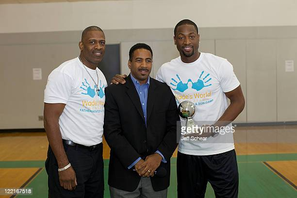 Dwyane Wade Sr and Dwyane Wade attends the Dwyane Wade Father Son Mentor Camp part of the Wade's World Weekend on August 25 2011 in Chicago Illinois