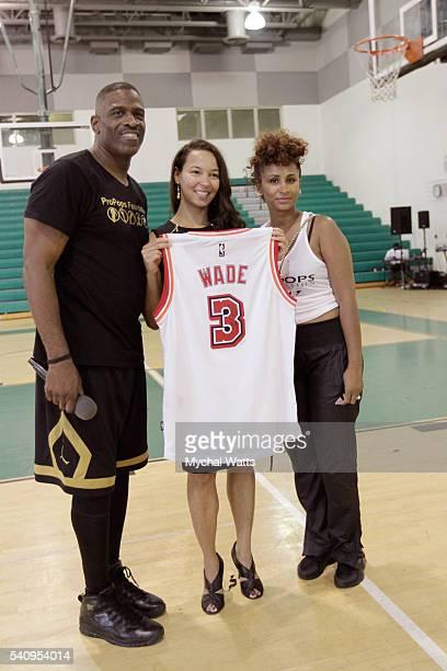 Dwyane Wade Sr and sponsor Breakthru Beverage Jenna Ingraham attend the Propops Foundation Fathers Day Weekend on June 18 2016 in Miami Florida