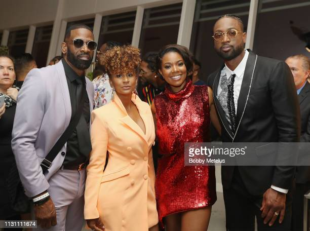 Dwyane Wade Sr Danielle Wade Gabrielle Union and Dwyane Wade attend the 6th Annual A Night On The Runwade at Aventura Mall on March 16 2019 in Miami...