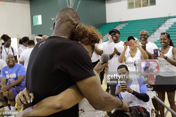 Dwyane Wade Sr Proposes to Danielle Koping in front of crowd at the Propops Foundation Fathers Day Weekend on June 18 2016 in Miami Florida