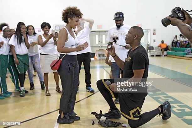 Dwyane Wade Sr proposes to his Fiancee Danielle Koping at the Propops Foundation Fathers Day Weekend Event on June 18 2016 in Miami Florida