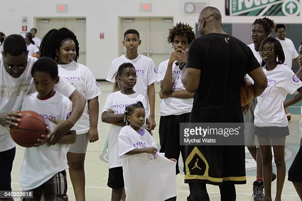 Dwyane Wade Sr Speaks with children at the Propops Foundation Fathers Day Weekend on June 18 2016 in Miami Florida