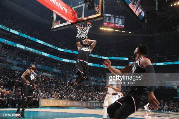 Dwyane Wade throws an alley oop to LeBron James of Team LeBron during the 2019 NBA AllStar Game on February 17 2019 at the Spectrum Center in...