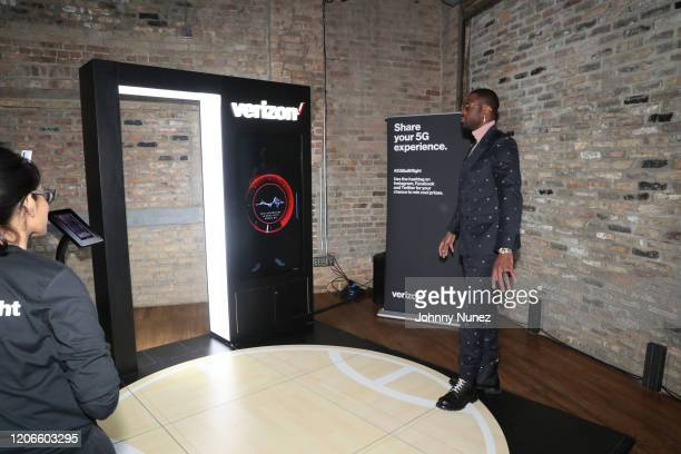 Dwyane Wade walks through the Verizon 5G AR experience at Stance Spades At NBA AllStar 2020 at City Hall on February 15 2020 in Chicago Illinois