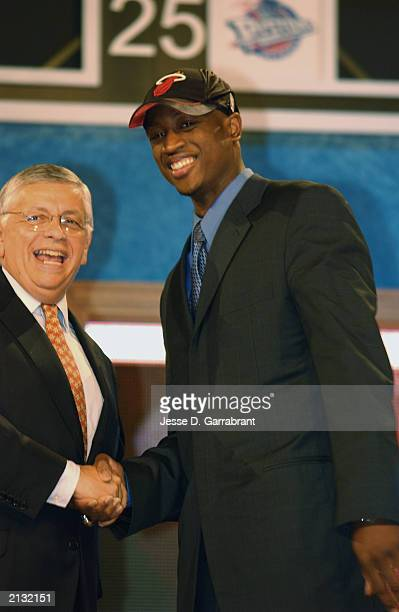 Dwyane Wade who was selected by the Miami Heat shakes hands with NBA Commissioner David Stern during the 2003 NBA Draft at the Paramount Theatre at...