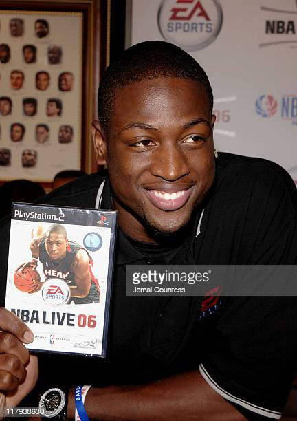 Dwyane Wade with EA Sports NBA Live 06 game at the exclusive premiere of EA Sports NBA Live 06 at the NBA Store in New York City on September 27 2005