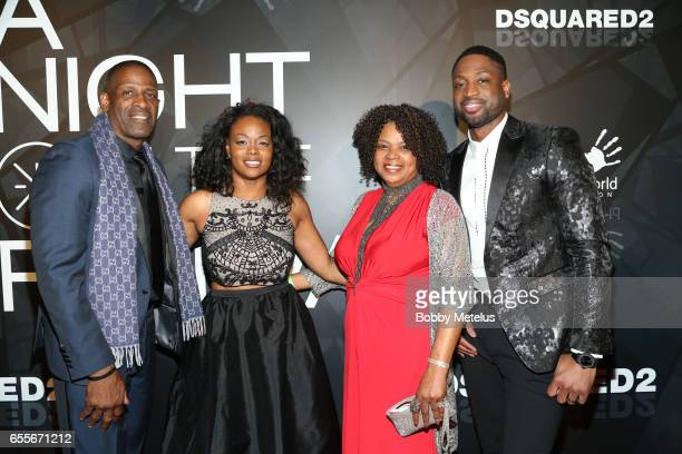 Dwyane Wade with parents Dwyane Wade Sr and Jolinda Wade alongside sister Tragil Wade on the red carpet at A Night on the Runwade Event at Revel...