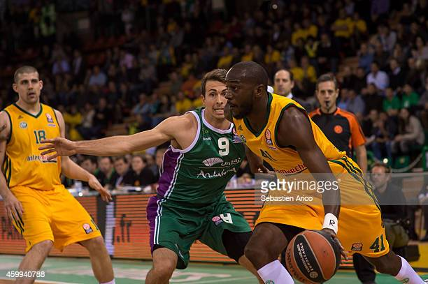 Dy BoungouColo #41 of Limoges CSP competes with Ryan Toolson #9 of Unicaja Malaga during the 20142015 Turkish Airlines Euroleague Basketball Regular...