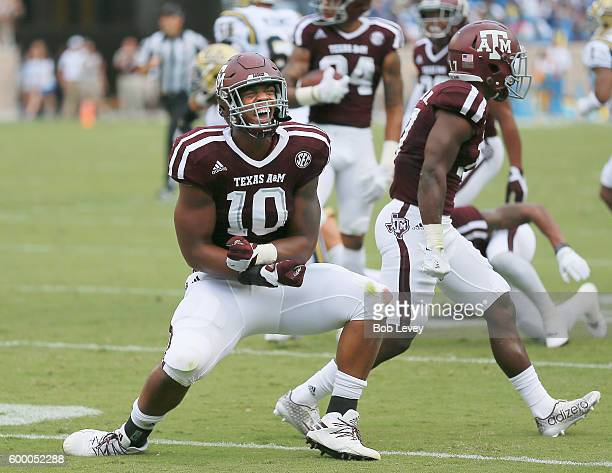 Dyaeshon Hall of the Texas AM Aggies reacts after a defensive stop against the UCLA Bruins on September 3 2016 in College Station Texas