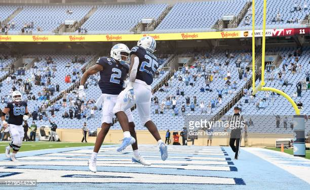 Dyami Brown and Javonte Williams of the North Carolina Tar Heels celebrate after a touchdown against the Virginia Tech Hokies during their game at...
