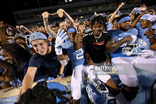 Dyami Brown of the North Carolina Tar Heels celebrates with students after a win against the Miami Hurricanes at Kenan Stadium on September 07 2019...