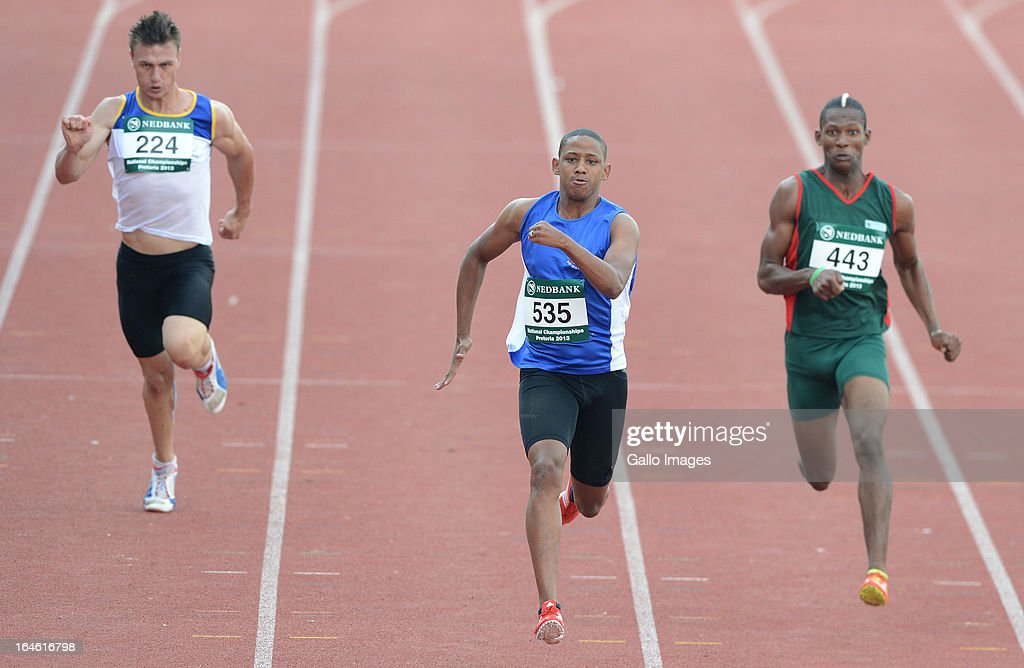 Dyan Buis of WP win the 200m from Willem Maree and Union Sekalwe during day 3 of The Nedbank National Championships for the Physically Disabled (Athletics) at LC de Villiers Stadium on March 25, 2013 in Pretoria, South Africa.