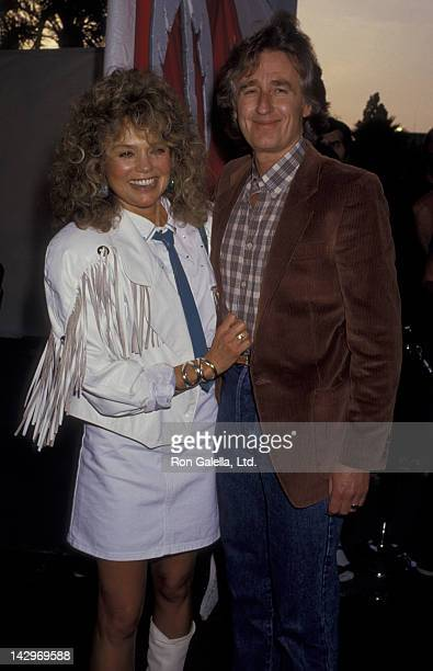 Dyan Cannon and Stanley Fimberg attend SHARE Boomtown Party on May 16 1987 at the Santa Monica Civic Auditorium in Santa Monica California