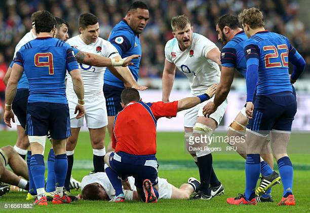 Dyan Hartley of England lies inhured following a heavy collision with Uini Atonio of France during the RBS Six Nations match between France and...