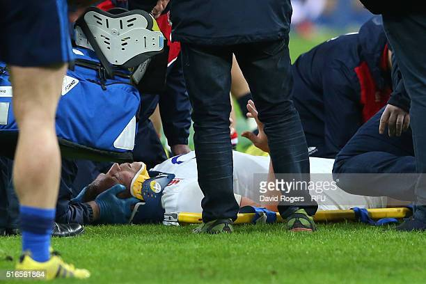 Dyan Hartley of England receives treatment following a heavy collision with Uini Atonio of France during the RBS Six Nations match between France and...