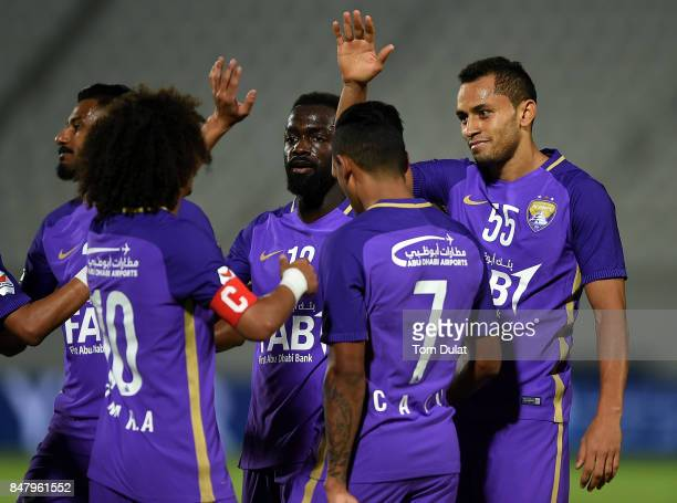 Dyanfrez Douglas of Al Ain celebrates scoring his sides second goal during the Arabian Gulf League match between Al Ain and Al Wasl at Khalifa bin...